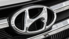 Car Logo Hyundai. NIZHNY NOVGOROD, RUSSIA - JULY 21, 2013: Auto show. Car Logo Hyundai Royalty Free Stock Photos