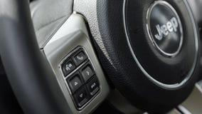 Car Logo Jeep. NIZHNY NOVGOROD, RUSSIA - JULY 21, 2013: Auto show. Car Logo Jeep. Steering wheel Stock Images