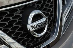Car Logo Nissan. NIZHNY NOVGOROD, RUSSIA - JULY 21, 2013: Auto show. Car Logo Nissan Stock Image