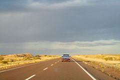 Car on a long road to the sky horizon Royalty Free Stock Photography