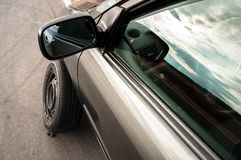 Car with loose tire Stock Photos