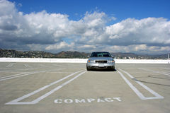 Car on the lot. Lonly car on the empty parking lot Royalty Free Stock Photo