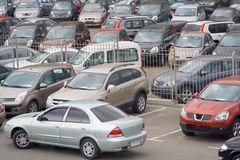 Car lot parking. Lot of new sedan jeep cars open sales site retail service dealer shop royalty free stock photography