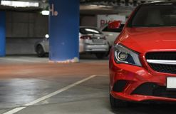 Car in lot underground parking. Side of red car on the underground parking Stock Images