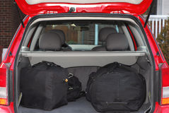 Car with luggage. Red hatchback car loaded with open trunk and luggage Stock Photography