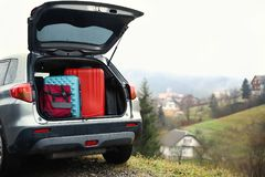 Car with luggage. In countryside Stock Image