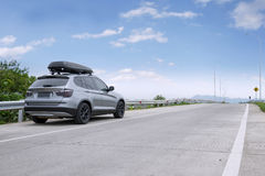 Car with luggage rack for traveling. Image of a car is parked on the roadside while carrying roof rack for traveling Royalty Free Stock Images