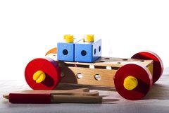 A car made by a child`s hands from parts of a wooden constructor. stock images