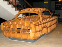 Car made out of wood, exhibited at the National Museum of Cars. Royalty Free Stock Photo
