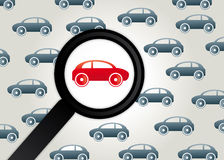 Car and magnifying glass. A red car is viewed through a magnifying glass. Wrong way driver. Wrong-way driving is the act of driving a motor vehicle against the Stock Image