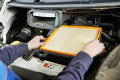 Car maintenance - air filter replacing Royalty Free Stock Image
