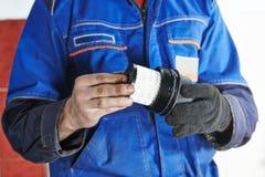 Car maintenance - oil filter replacing Stock Photo