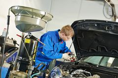 Car maintenance, oil and filter replacing Royalty Free Stock Photos