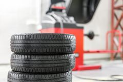 Car maintenance and service center. Vehicle tire repair and replacement equipment. Seasonal tire change royalty free stock photo