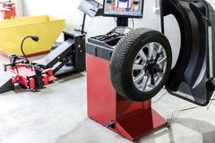 Car maintenance and service center. Vehicle tire repair and replacement equipment. Seasonal tire change stock photography