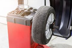 Car maintenance and service center. Vehicle tire repair and replacement equipment. Seasonal tire change.  stock photo