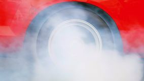 Car make tires warm up with smoke stock video footage
