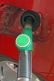 Car makes a supply of green unleaded fuel Stock Photos