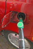 Car makes a supply of green unleaded fuel Stock Image