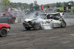 Demolition derby. Napierville demolition derby, July 12, 2015, picture of white wrecked car making a smoke during the demolition derby royalty free stock images