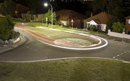 A car making a U-turn light trail Stock Photo