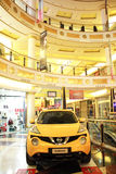 Car in the mall. Yellow Nissan car inside Euroma 2 shopping center in Rome, Italy Royalty Free Stock Photography