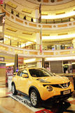 Car in the mall. Yellow Nissan car inside Euroma 2 shopping center in Rome, Italy Royalty Free Stock Images