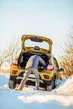 Car and man on snowy road Stock Images