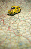 Car on a map. Planning your holidays Stock Image
