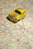 Car on a map Stock Images