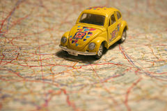 Car on a map Royalty Free Stock Photo
