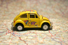 Car on a map Royalty Free Stock Images