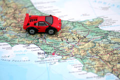 Car and map. A Red car and map of Italy stock photos