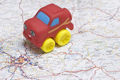 A car on the map. Stock Photography