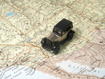 A car on a map Royalty Free Stock Photo