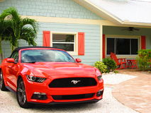 Car matching with the house. Mustang camaro salmon pink Stock Images