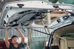 Car mechanic is assembling royalty free stock photo