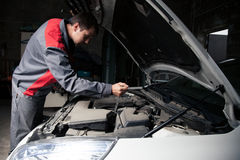 Car mechanic. Auto repair service. Royalty Free Stock Images