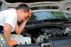 Car mechanic in auto repair service. Car mechanic working in auto repair service Royalty Free Stock Photography