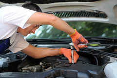 Car mechanic in auto repair service Stock Photo