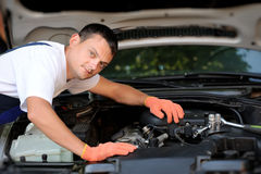 Car mechanic in auto repair service Royalty Free Stock Image