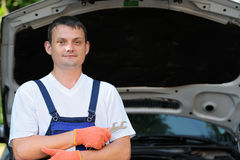Car mechanic in auto repair service Royalty Free Stock Photos