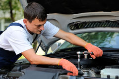 Car mechanic in auto repair service Stock Image
