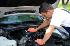 Car mechanic in auto repair service Royalty Free Stock Photo