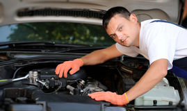 Car mechanic in auto repair service Royalty Free Stock Images