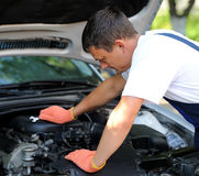 Car mechanic in auto repair service Stock Images