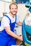 Car mechanic and auto in service workshop Stock Photography
