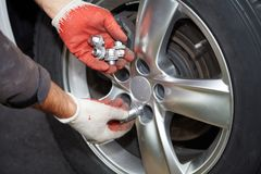 Car mechanic changing tire. Stock Images