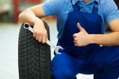 Car mechanic changing tires Royalty Free Stock Photo