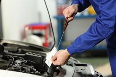 Car mechanic checking oil level stock photos